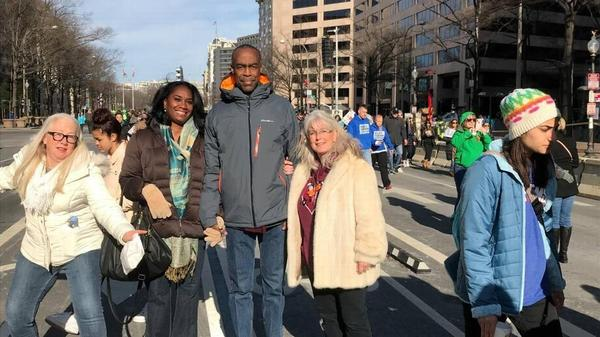 Broward County Schools Superintendent Robert Runcie leaves his Washington, D.C., hotel for March For Our Lives with School Board member Abby Freedman on one arm and his wife on the other, Saturday, March 24, 2018.