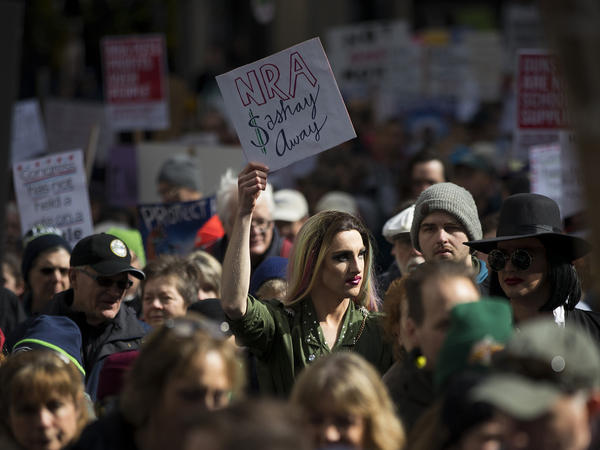 """Jesse Pettibone, 23 (center), participates in the Seattle """"March for Our Lives."""" """"I'm here today because youth, queer people and people of color are often the victims of gun violence, and we need to disarm that hate now,"""" Pettibone said."""