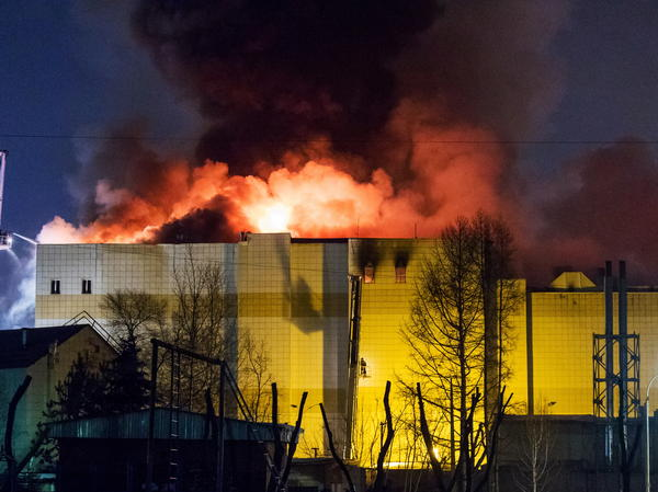 Flames rise from the Zimnyaya Vishnya shopping center in Kemerovo, where at least 64 people have died.