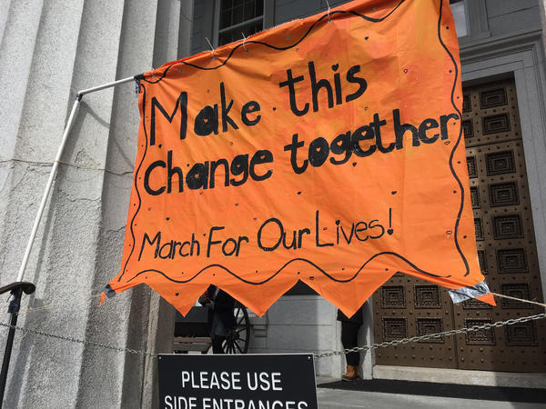 "This sign hung behind the speaker podium at the Vermont Statehouse during the ""March For Our Lives"" rally."