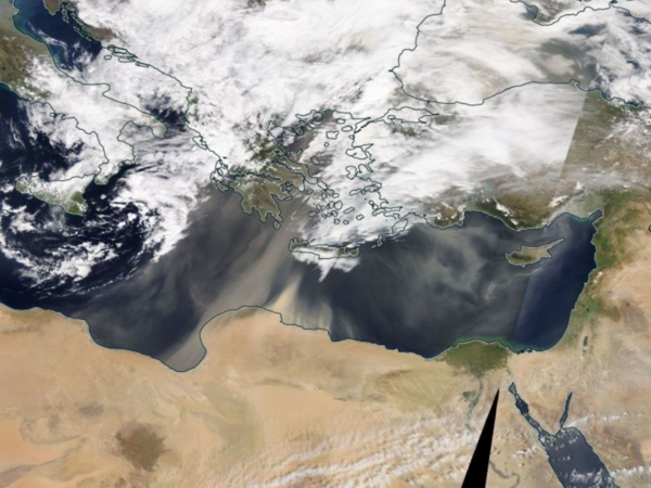 Satellite images from NASA show sand blowing from North Africa into Southern and Eastern Europe on Monday.