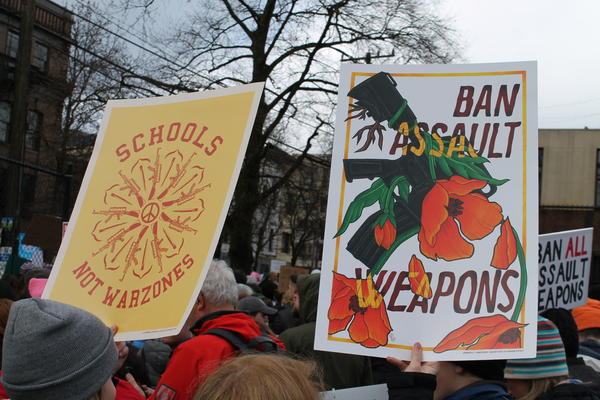 Demonstrators in Seattle carried colorful homemade signs as they marched through downtown to Seattle Center during Saturday's March For Our Lives