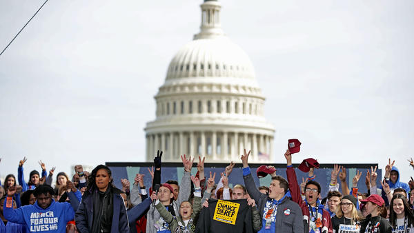 """Young victims of gun violence, including students from Marjory Stoneman Douglas High School, stand on stage at the conclusion of the """"March For Our Lives"""" rally Saturday in Washington, D.C."""