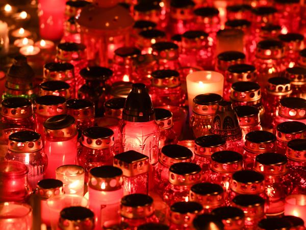 People light candles to pay tribute to the victims of a Zimnyaya Vishnya (Winter Cherry) shopping center blaze in the Siberian city of Kemerovo. At least 64 people, many of them children, died in the incident.