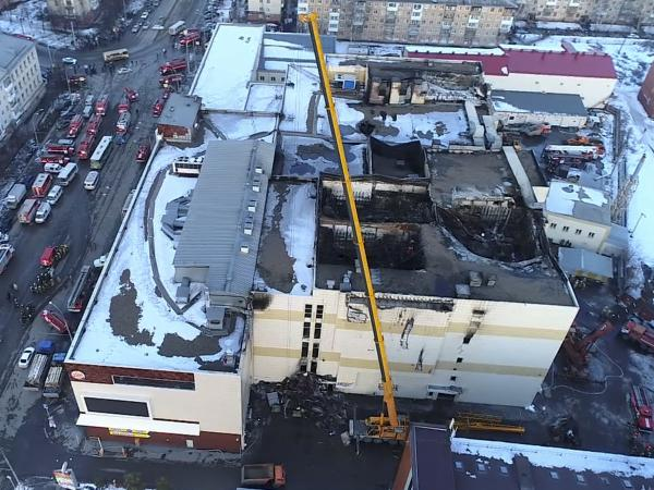 This Russian Emergency Situations Ministry photo, taken on Monday, shows an aerial view of emergency services working at the scene of the multistory shopping center after Sunday's fire.