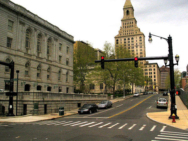The intersection of Arch and Prospect Streets in Hartford, Conn., with a view of City Hall and Travelers Tower.