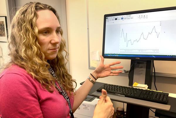 Boston Medical Center epidemiologist Traci Green reviews data that tracks fentanyl-laced cocaine overdose deaths in Rhode Island. (Martha Bebinger/WBUR)