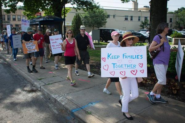 As immigration officials increasingly target immigrants without criminal backgrounds, families with children who are U.S. citizens are preparing for the possibility they might be deported. Above, volunteers march through Brookside.