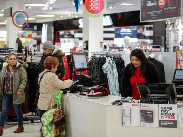 A shopper makes a purchase at the J.C. Penney store in North Riverside, Ill., Nov. 17. U.S. consumer spending grew in the fourth quarter at its fastest pace in three years.