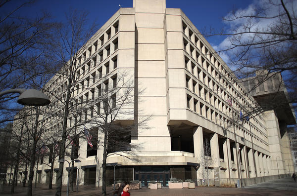 An internal Justice Department watchdog is opening a review of the Department of Justice and the FBI (headquarters pictured here), over alleged abuse of surveillance authority.