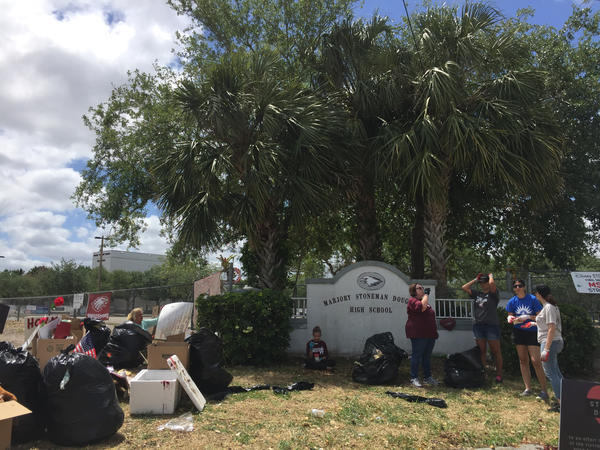Volunteers help pick up and organize Marjory Stoneman Douglas High School remembrances. They will be placed in storage and used for a memorial in the future.