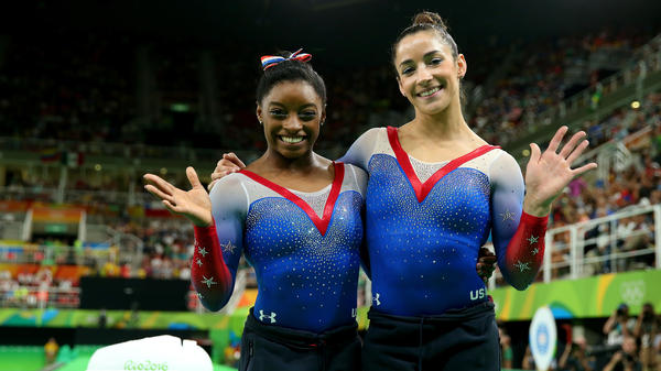 Simone Biles (left) and Aly Raisman in 2016. Both gymnasts say they were sexually abused by Larry Nassar. A public relations firm monitored both of their Twitter accounts, according to a report.
