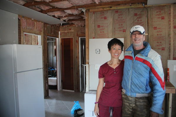 Lisa and Bill Tubbs are essentially camping out in their own home while they wait for building permits and local contractors to have time in their schedules.
