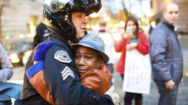 A photo of 12-year-old Devonte Hart went viral in 2014 as he hugged a police officer during a protest against police violence. Less than four years later, the now-15-year-old is feared dead alongside his entire family in a car crash.