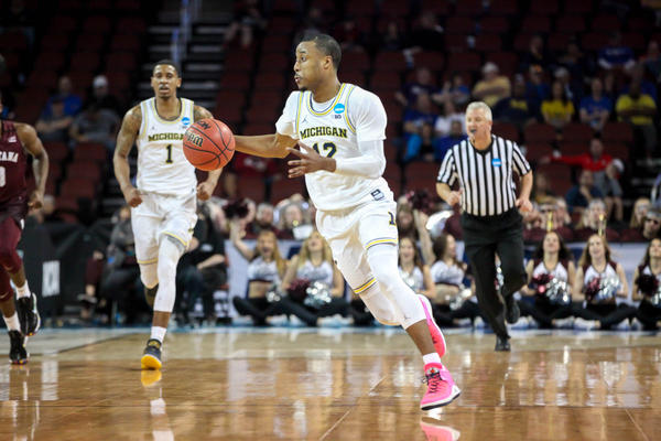 """When it comes to who wins between Loyola and Michigan, Bacon's money is on Michigan. Loyola had a """"great team, great run, great story,"""" he said, but they're just not up for the challenge of taking down Michigan."""