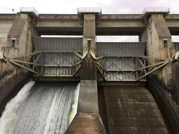 <p>Water flows through an open spill bay at The Dalles Dam.</p>