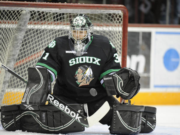 "The University of North Dakota's Brad Eidsness makes a save during a game against the Minnesota Golden Gophers. Since 2005, there have been a series of lawsuits and legislative actions over the nickname for the school's athletic teams, the ""Fighting Sioux."""