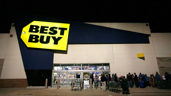 Black Friday shoppers wait in line outside Best Buy on Nov. 26, 2010, in Fort Worth, Texas. Best Buy will shut down 50 of its large stores while testing new stores that are 20 percent smaller.