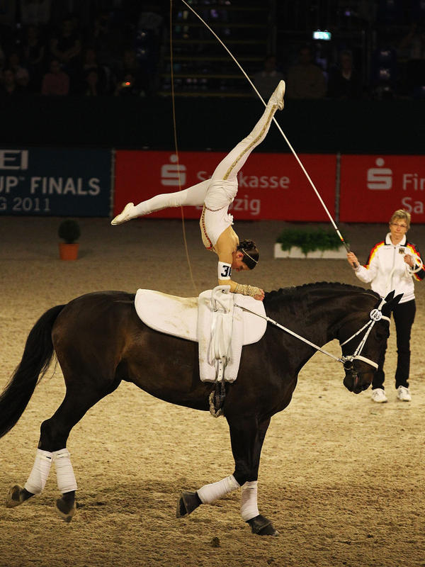 """Simone Wiegele of Germany riding """"Arkansas"""" in action during a 2011 competition in Leipzig, Germany. The sport is becoming more popular in the American northwest, and parents of kids who learn horse vaulting say it helps teach concentration and confidence."""