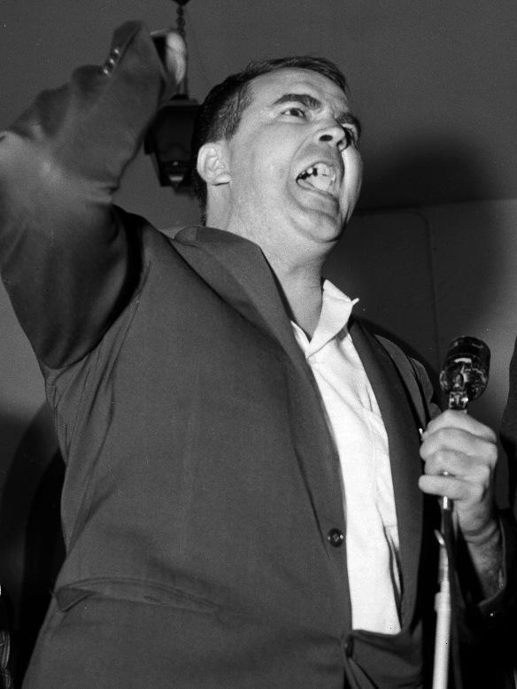 White Citizens' Council leader Asa Earl Carter denounces school integration in Clinton, Tenn., on Aug. 31, 1956.