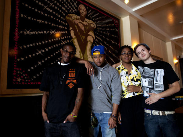 Left to right: Youth Radio participants Evan Childress, 21; Brandon McFarland, 26; Rayana Godfrey, 18; and Skylar Tye Bryant, 18, pose in front of a portrait of Marvin Gaye at the Washington, D.C., restaurant Marvin.