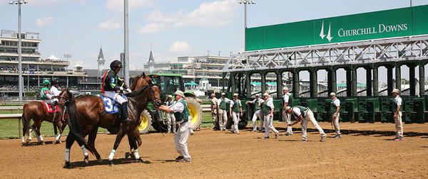 Cajoling horses into the starting gates of the Kentucky Derby is the start crew's challenge.