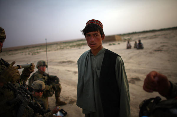 An Afghan man is questioned as he is entered into a biometric identification system — a database of every person the soldiers encounter in the field.
