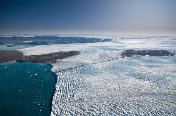 Researchers studying Greenland's ice say it is melting more slowly than previously thought. Here, ice travels down a relatively small outlet glacier into the sea.