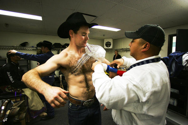 Ross Coleman has his shoulder wrapped after his bull ride during the 2007 Versus Invitational Professional Bull Riding Tournament at Madison Square Garden.