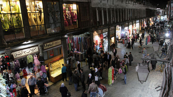 People walk through Hamidiyah market in Damascus, Syria, Feb. 28. The merchants of this landmark bazaar were once ardent supporters of President Bashar Assad. That's no longer the case.