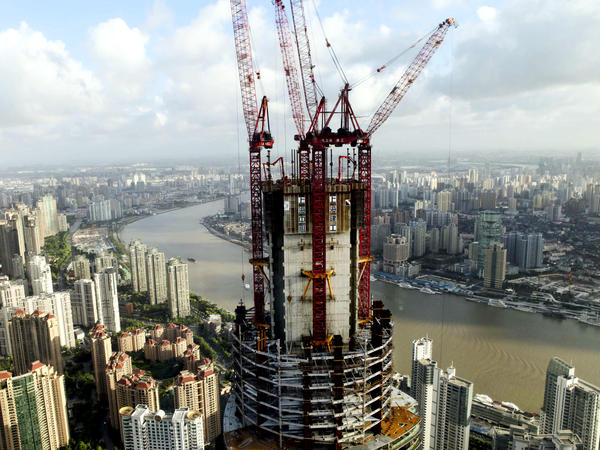 China's growing economic might means that it has increasing power to push back against US policies that it does not like, according to analysts. This photo from August shows the construction on the Shanghai Tower, which will be the tallest building in Shanghai.