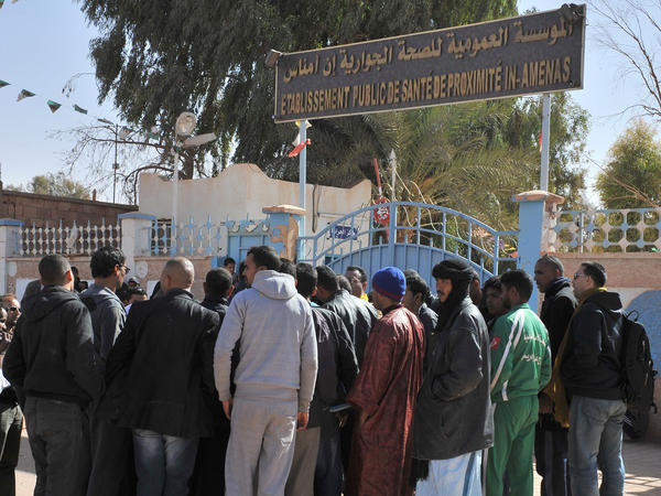 People gather Friday outside a hospital in eastern Algeria as they try to get information on those wounded during a military raid on a gas plant where Islamic extremists were holding hostages.