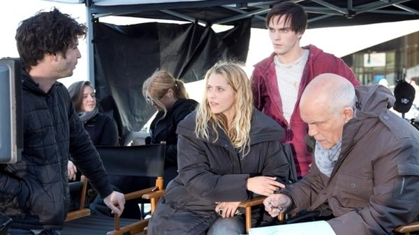 Director Jonathan Levine (far left) offers script notes to Teresa Palmer, Nicholas Hoult and John Malkovich on the set of <em>Warm Bodies</em>.