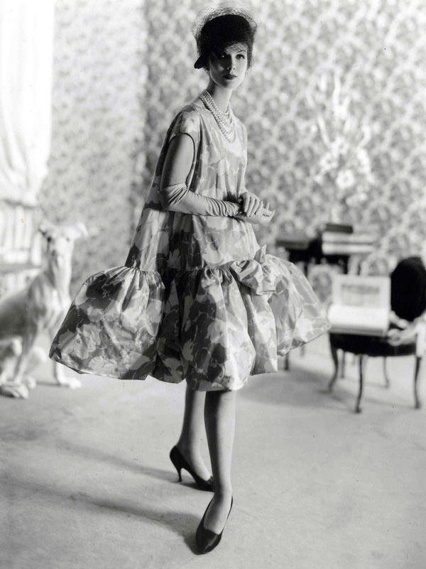"Balenciaga debuted his baby doll dress in 1958. Blume writes, ""all women benefited — and benefit still — from the principal achievement of [Balenciaga's] 1950s lines: the elimination of a tight nipped-in waist and the smoother, more yielding silhouette."""