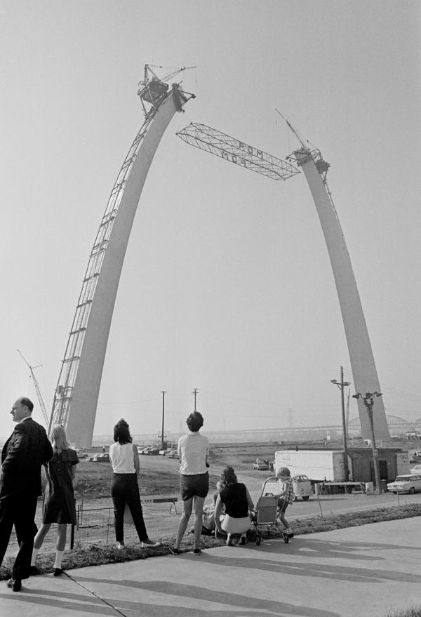 A 60-ton steel strut is lifted into place joining the two towers of the Arch on June 17, 1965.