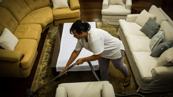 Cassia Mendes, who has worked as a housekeeper for more than 20 years, cleans a house in Sao Paulo, Brazil, on Feb. 19, 2012. Brazil enacted on April 2 a constitutional amendment to grant domestic workers health insurance and other benefits.