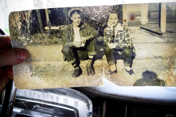 Pierson shows a photograph of Elvis Presley and Betty Ann McMahan sitting on the curb across from the Lauderdale Courts housing project where the Presley family lived from 1948 to 1953.