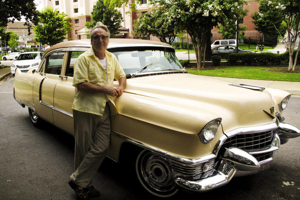 American Safari tour guide Tad Pierson stands beside his 1955 Cadillac. Visitors to Memphis can get a personalized tour that highlights the city's rich music heritage.