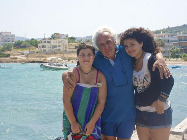 Marios Sousis, 75, with his granddaughters Linda, 13, and Annita, 14.