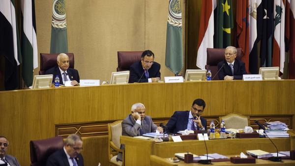 Arab League Secretary General Nabil Al Arabi (L) and Egypt Foreign Affairs minister Nabil Fahmi (C) head a meeting of the Arab League at the body's Cairo headquarters on Sunday.