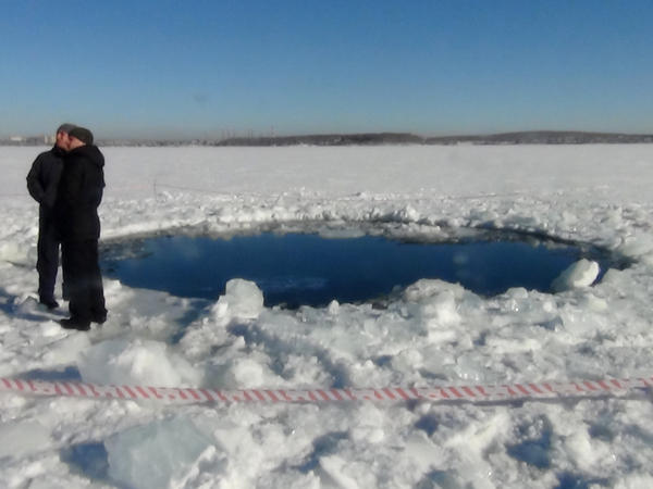 """The largest fragment of the Chelyabinsk meteor punched a hole in the frozen surface of Lake Chebarkul. The 1,200-pound stone was <a href=""""http://www.youtube.com/watch?v=xaehWpT7two"""">recovered from the lake bed</a> last month."""