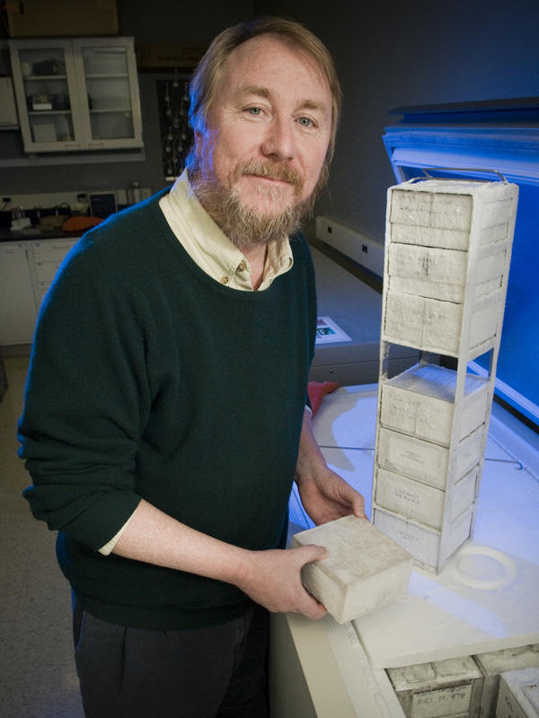 Michigan State's Richard Lenski pulls cultures of bacteria from a lab freezer.