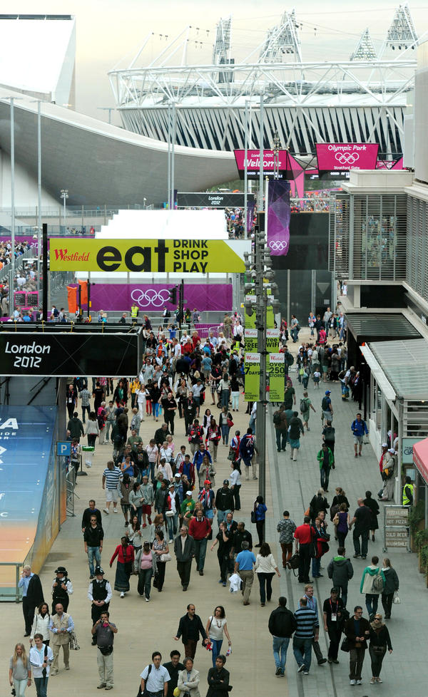 Visitors walk through Westfield Shopping Centre, near London's Olympic Park, on Aug. 1, 2012. The area continues to thrive economically — at least for now.