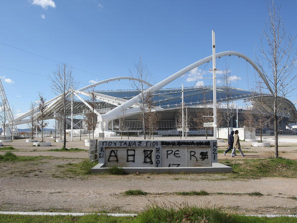 Graffiti covers a vent adjacent to the Athens Olympic Stadium in this photo from Feb. 18, 2012. Expenditures on the 2004 Athens Summer Games contributed to the country's debt load, which sparked the current economic crisis.
