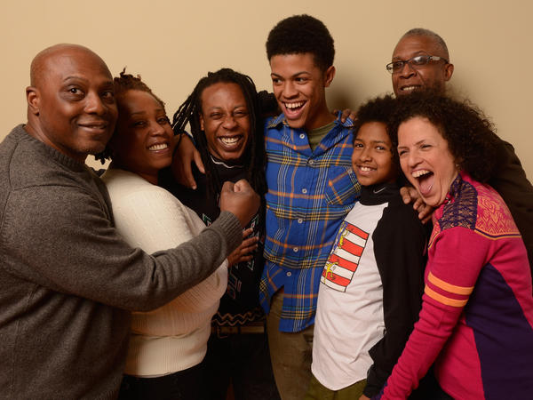 Two families are featured in <em>American Promise</em>: Tony and Stacey Summers (left) stand next to their son, Seun. Filmmakers Michèle Stephenson and Joe Brewster are with sons Idris and Miles (right).