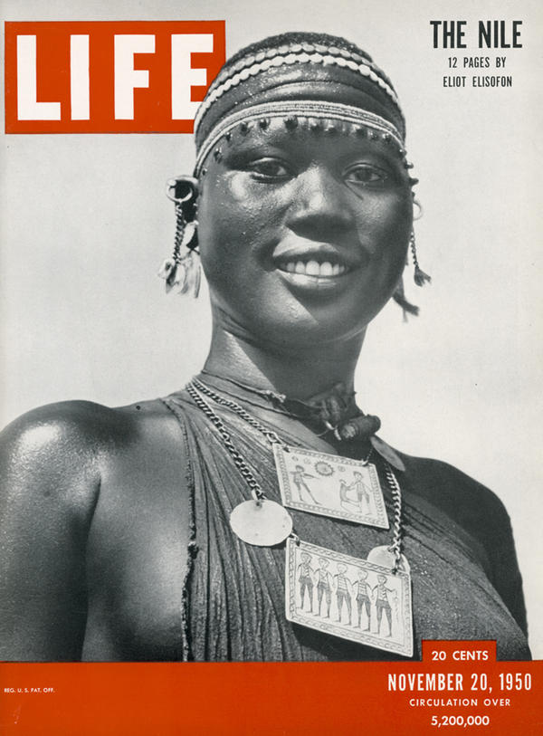 """This Shilluk woman appeared on the cover of <em>Life</em> magazine, The Nile issue, Nov. 20, 1950. Her pendants feature etchings of Sudanese village life. """"[They] are made out of aluminum that came from a downed airplane,"""" Staples explains. Elisofon bought the pendant: He liked showing how the traditional mixed with the modern in African design and crafts."""
