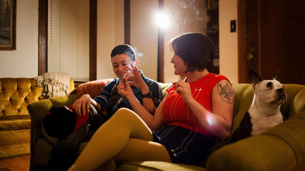 Cohen passes a joint to her friend Mika Loudon at her home in Seattle, Wash.