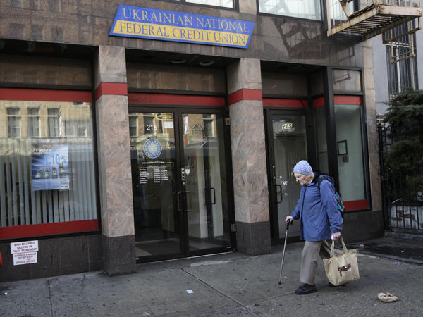 A woman walks past the Ukrainian National Federal Credit Union in the Ukrainian neighborhood in Manhattan's East Village. New York is home to tens of thousands of Ukrainian and Russian immigrants.