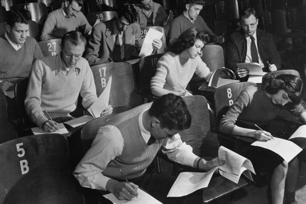 World War II veterans and other students at the University of Iowa in 1947. That year, due to federal assistance from the GI Bill, 60 percent of the school's enrollment was made up of veterans.