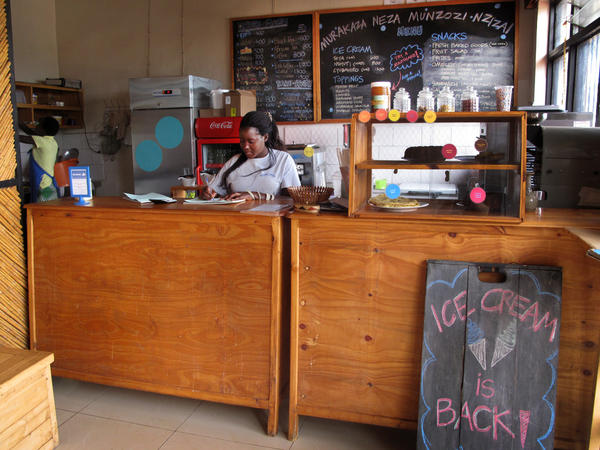Alphansine Uwimana writes an order at Inzozi Nziza, or Sweet Dreams, Rwanda's first and only ice cream shop. There are logistical challenges, like power cuts, as well as cultural ones in a country where ice cream is not traditionally popular and women don't often run businesses.